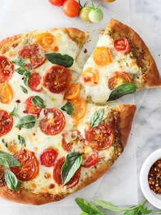 Pesto pizza with fresh tomatoes and mozzarella
