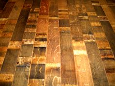 "Reclaimed Oak Wine Barrel Flooring.  This is called ""Stave"" flooring.  The wood from the barrels is steamed straight and then milled for use as flooring.  It is prefinished and tongue and groove for easy install.    #floor #reclaimedfloor #woodfloors #oldwood #reclaimedwoodflooring #backsplash #featurewall @ReclaimedDW"