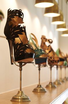 Hmm candle sticks could hold shoes like that. Would be pretty for decor in closet