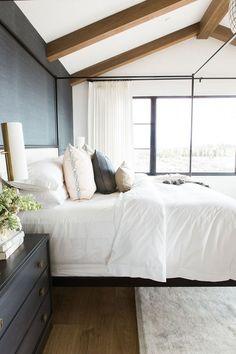 serene bedroom, white sheets, beams, grasscloth walls