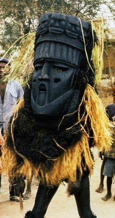 Africa | Arochukwu, Ekpo masquerade, September 20, 1988, Amaikpe square. ||  The huge mask called Ekperem is the last to appear during an Ekpo performance. | ©Eli Bentor.