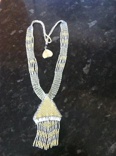 Necklace. Yellow, white or grey seed beads.