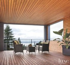 A #modern Seattle home's #cedar-clad #deck overlooks #waterfront views. See more at www.luxesource.com. #luxe #luxemag #luxury #design #interiordesign #interiors #home #house #dwelling #residential #decor #homedecor #interiordecorating #interiordesignideas #architecture #terrace #porch