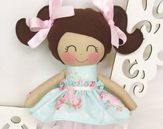This is a 14 inch Cloth Doll that is part of the Dancing Doll collection from Sew Many Pretties.  This is plush doll is handmade from 100% cotton fabrics and wool blend felt for her hair. Facial features are hand embroidered. Her satin hair bows are sewn securely. This doll wears a tutu lined with pink satin ribbon and is removable with an elastic waistband. Her ballet felt pointe shoes are sewn on so she never has to worry about losing them.  Let this special handmade doll inspire a childs…