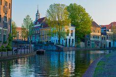 Koop 'Zonsondergang over de oude binnenstad van Schiedam' van Marco van Dijk voor aan de muur.