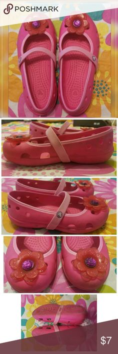 Mary Jane Flower CROCS ~ Toddler Girl's Sz. 11 - Adorable CROCS shoes for Toddler Girl's in size 11. Mary Jane style with strap across top, lightweight and comfortable with a cute flower on toe (Not removable). Pre-loved, have some scratches/indentations as pictured. A little dirty, should come mostly clean with a soak in mild soap and water :-) CROCS Shoes