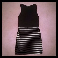 Sleeveless Dress M. Sleeveless one piece dress. Black on top half with cute pocket, and bottom half black with white stripes. Forever 21 Dresses Mini