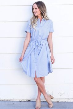 Blue pinstriped,  button up dress with a tie around the waist, this will be  your go to summer dress!  Model is 5'10'' and wearing size Small  100% Rayon