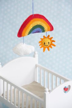 Sunny Days Baby Mobile - Brighten up baby's room with the Sunny Days Baby Mobile. The happy sun, colorful rainbow and puffy cloud are sure to bring a smile to your little one's face. This plush mobile also makes an adorable shower gift for expectant parents. From the April 2015 issue of I Like Crochet