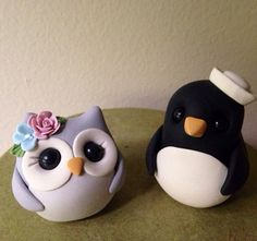 This listing is for a precious penguin and owl keepsake wedding cake topper as pictured...you may choose flower color :)    They are made from