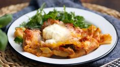 Recipe with video instructions: If you're craving lasagna, but don't have an oven, this ridiculously cheesy and simple skillet pasta is for you. Ingredients: 2 Tbsp olive oil, 1 small onion, finely diced, 4 cloves garlic, chopped, 1 (16 oz) package Italian turkey sausage, removed from casing or bulk, ½ (5 oz) bag baby spinach, 1 (28 oz) can diced tomatoes, with their juices, 1 cup tomato sauce, 10 curly lasagna noodles, broken in half or thirds, ¼ cup water, ⅔ cup ricotta cheese, ⅓ cu...