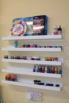 """Ribba picture shelves from Ikea, these are the smallest size"" I need to do this for my nail polish and stuff. Might be handy in a craft/sewing room"