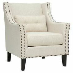 """The perfect addition to your living room or den, this foam-cushioned arm chair showcases a wood frame and nailhead-trimmed upholstery.     Product:  ChairConstruction Material: Linen, polyester, birch wood and polyurethane foam Color: Beige and blackFeatures:20"""" Seat height  Accent pillow includedNon-marking feet  Nailhead trim Removable cushions  Dimensions: 37"""" H x 32"""" W x 32"""" D"""