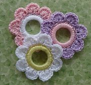 """Flower Ring Decoration/Ornament is crocheted around a 2"""" plastic ring."""