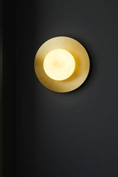 Moons white marble round wall sconce. Matlight.
