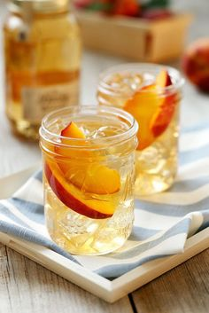 Twirl and Taste - Front Porch Peach Tea with a punch for your next party - FRONT PORCH PEACH TEA 2 parts Ole Smoky® Peach Moonshine™ 1 part sweet tea  1 part lemonade  Mix it up and serve over ice in a Mason fruit jar - Garnish: sliced peaches or mint