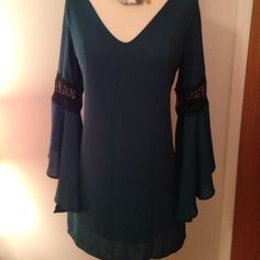 """Karlie belle sleeve top Gorgeous deep teal. Almost emerald. Fluted sleeves. Completely lined. Med or large. 32 long. 38 bust. Sleeves are 20"""" long. Posh rules only. karlie Tops"""