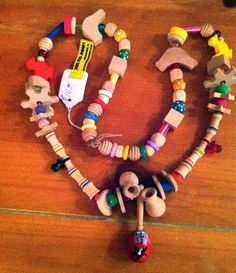 Make a bird toy necklace for couch bonding time