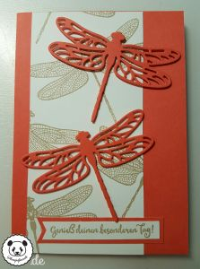 handmade card from Stamped panda ... like this layout with a pair of lacy die cut dragonflies and a panel of randomly stamped dragonflies ...