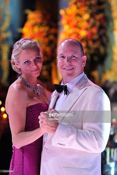 In this handout photo provided by Realis/SBM, Princess Charlene of Monaco and Prince Albert II of Monaco dance during the 63rd Red Cross Ball at the Sporting Monte-Carlo on August 5, 2011 in Monte-Carlo, Monaco.
