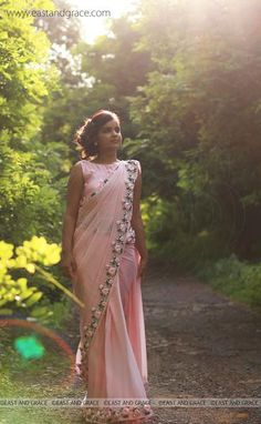 Featuring a balmy baby pink pure chiffon saree with beautifully embroidered satin pink rose vines along the edges which is embellished with French knots and glistening pink pearls. Sari Design, Chiffon Saree, Silk Chiffon, Sari Rose, Embroidery Saree, Ribbon Embroidery, Ribbon Work, Silk Ribbon, Elegant Saree