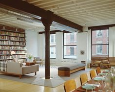 This full floor of a former butter warehouse was left mostly open to keep the drama of its 80-foot long interior. Sustainable bamboo floors and cabinetry are tailored simply with exposed steel against a quiet backdrop of white walls and natural gray concrete. Polycarbonate screens conceal service areas when desired.  IKB: Ike Kligerman Barkley Architects New York & San Francisco | Projects | Loft in Tribeca