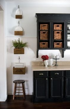The old boxes hanging on wall would be great for storing magazines and books.
