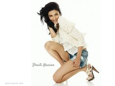 #ShrutiHaasan wearing a white lace printed top with a shrug along with a pair of #denimshorts flaunting her sexy #seductive legs boldly in a pair of ankle #strapheels.