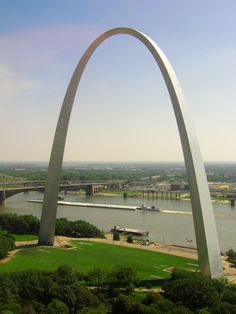 The Mississippi River and St Louis Arch seen from the Top of the Riverfront restaurant.  A towboat with barges is about to go under the historic Eads Bridge.  To purchase a print go to: http://garry-mcmichael.artistwebsites.com/featured/top-of-the-riverfront-garry-mcmichael.html