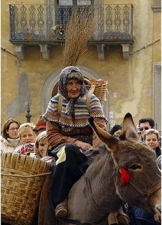 In the Italian folklore, Befana is an old woman who delivers gifts to children throughout Italy on Epiphany Eve (the night of January 5) in a similar way to Sinterklaas or Santa Claus.