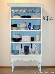 Put a bookcase on a table. Add crown molding , cup hooks, and beadboard.