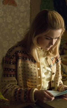 Sally Draper's ruffled blouse and printed cardigan in Season 7 of Mad Men.