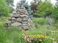 The gravel garden at Northwind Perennial Farm in Burlington, WI was designed by Roy Diblik and the beautiful, dry stacked stone pyramid was designed by Steve Coster.