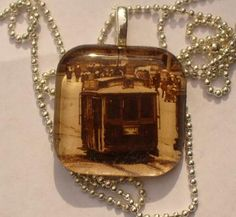 Salvaged from an old sepia toned postcard this steet scene is now behind glass with a silver plated ball chain. Stocking Stuffers For Women, Glass Tile Pendant, Ball Chain, Rage, Silver Plate, Christmas Ornaments, Holiday Decor, Artwork, Beautiful