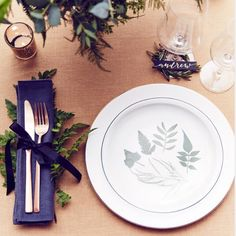 Foliage place setting with DIY charger plates, fern cutlery and rosemary wreath glass markers. Styling, Laura Burkitt. Photography, Nato Welton for Brides Magazine