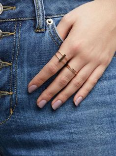 """This 14k gold-fill ring features a 1"""" bar upon two soldered thin bands that make an elegant yet understated statement ring. Our jewelry is skillfully crafted by"""