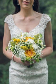 Yellow wild flower bouquet. Yellow Roses, Baby's breath, Craspedia Billy Balls See more here: http://www.greenhollyweddings.com