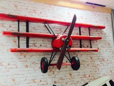 Red Baron Plane Shelves. Awesome wall hanging replica, fully welded metal, this plane is just perfect for a stunning vintage-style bedroom for boys storage or the office, bar storage space