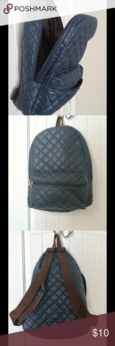 Blue Quilted Backpack Great condition. Faux leather with Quilted pattern. Navy blue with brown adjustable straps and brown interior. Bags Backpacks