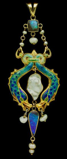 An Arts & Crafts Dolphin Pendant, by JAMES CROMAR WATT, c. 1900, Scotland. Enamelled gold with opal and pearl.