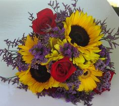 Sunflowers, roses and limonium...great summer bouquet.