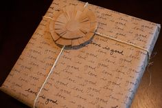 DIY Handwritten Wrapping Paper. All you need is an old paper shopping bag. Yay recycling!
