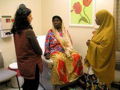 Dr. Wilson talks to a Somali Bantu patient using an interpreter. Date: May 2008 Location: Lewiston, Maine  Photographer: Katie Minton