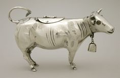 Dutch solid silver and glass cow creamer.