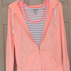 ✨Lightweight Peach Hoodie & Striped Tank OLD NAVY peach lightweight hoodie - 60% cotton/40% polyester.  Some paint is chipped off zipper (see photo).  Also included matching tan/white stripe Old Navy tank with peach trim around neckline and arm openings.  Very faint marks on bottom front of tank (see photo).  Great spring and summer ensemble! Old Navy Tops