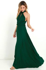 """As Seen On Kyrzayda of Kyrzayda blog! Versatility at its finest, the Tricks of the Trade Forest Green Maxi Dress knows a trick or two... or four! Two, 74"""" long lengths of fabric sprout from an elastic waistband and wrap into a multitude of bodice styles including halter, one-shoulder, cross-front, strapless, and more. Stretchy jersey knit hugs your curves as you discover new ways to play with this fascinating frock. Full, maxi-length skirt has a raw hemline. Want Styling Tips? <a…"""