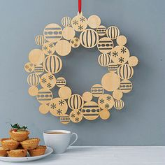 Die cut wooden ornaments wreath. I could do this with my die cut snowflakes!