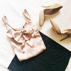 Beige Bow Top I bought this top when I was studying abroad in Paris ❤️. It looks cute with a black pencil skirt and black heels. The 2nd picture is more true-to-color. The front is satin-y and the back feels like cotton. The size is not on the tag, but I believe it's a medium. The flaws are shown above. 100% Viscose.  ✅Reasonable offers welcome! ✅BUNDLE DISCOUNTS! No trades/paypal/other apps. No lowball offers. Tops Tank Tops