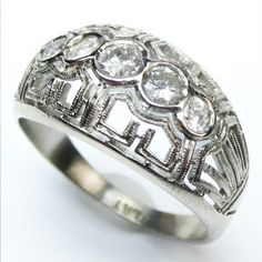 Honeycomb: The unusual latticework motif of this ring reminds us of a honeycomb with bright white antique diamonds adding just the right amount of shimmer.   Ca 1930.  Maloys.com