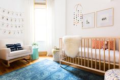 A vintage blue rug pairs perfectly with this mid-century mod nursery Photography: Carolina Rodriguez  - carolinamariana.com   Read More on SMP: http://www.stylemepretty.com/2016/02/01//